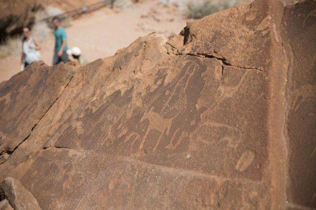 Historic petroglyphs on the entrance of a cave.