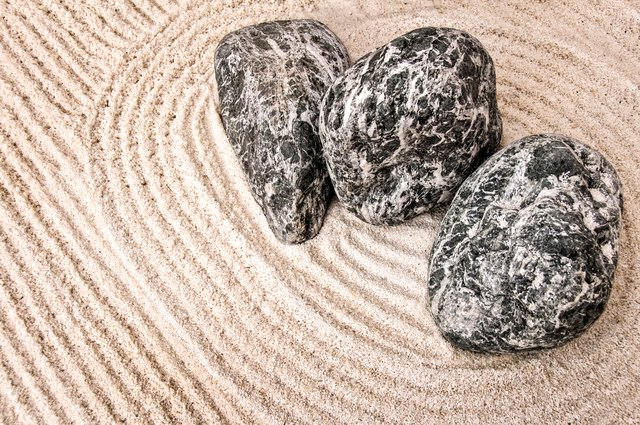 Zen gardens use sand and stones to create the illusion of water and land.