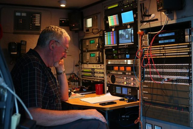 A technician at work in a media van.