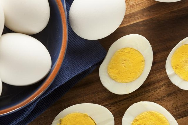 Hard boiled eggs on a wooden table.