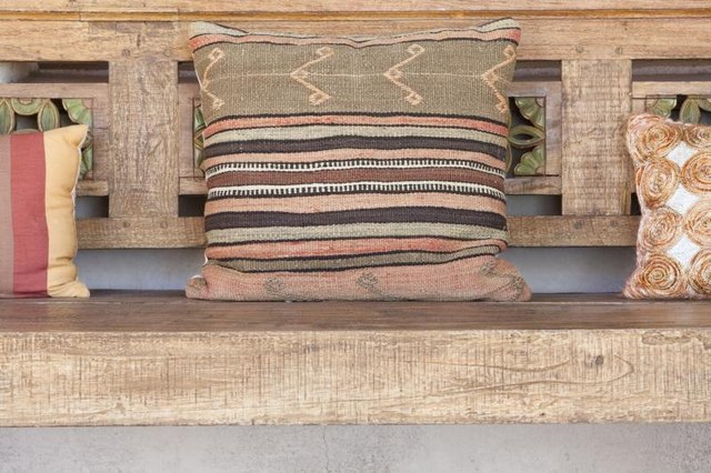 Cushions on a wood bench.
