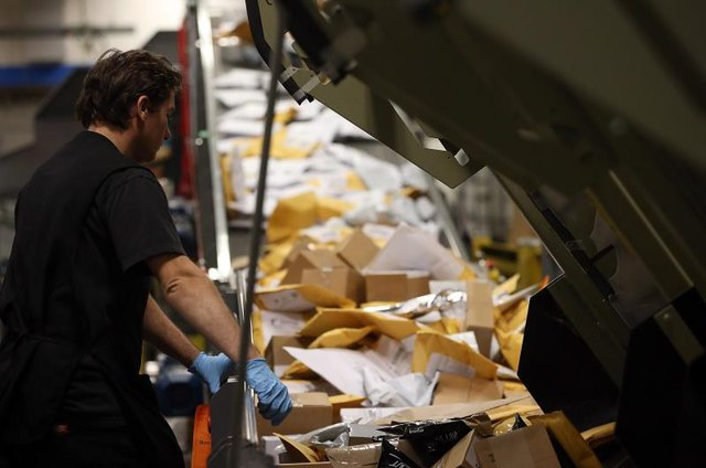 The postal service delivers nearly 210 million pieces of first-class mail daily.
