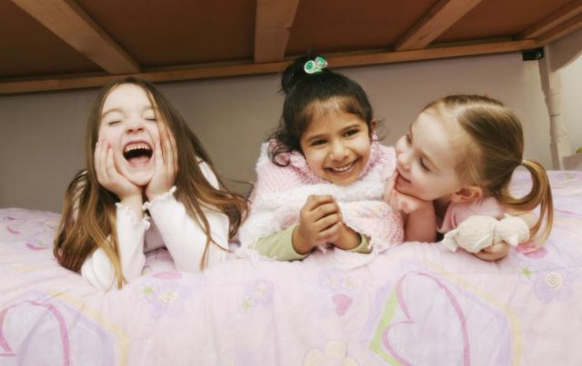 Young girls having a sleepover party