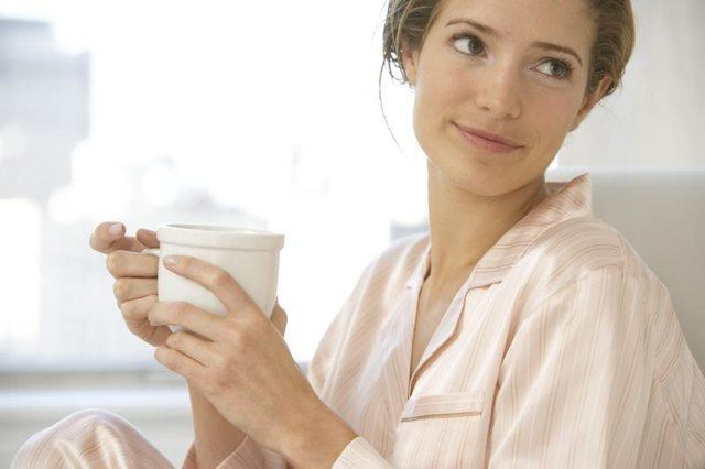 Woman holding cup of coffee.