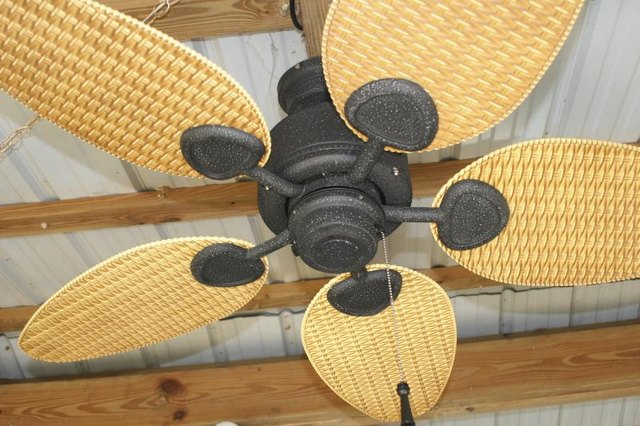 An electric ceiling fan mounted on a patio.