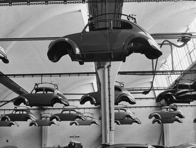 Volkswagen Beetles being manufactured in factory circa 1965