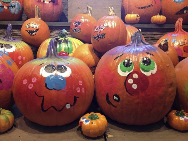Acrylic paints provide bold, even coloring on a painted pumpkin.
