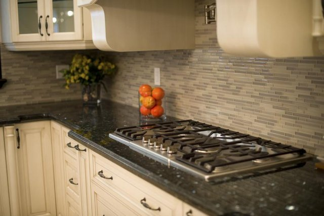 Decorating ideas for a kitchen with blue pearl granite ehow for White kitchen cabinets with blue pearl granite