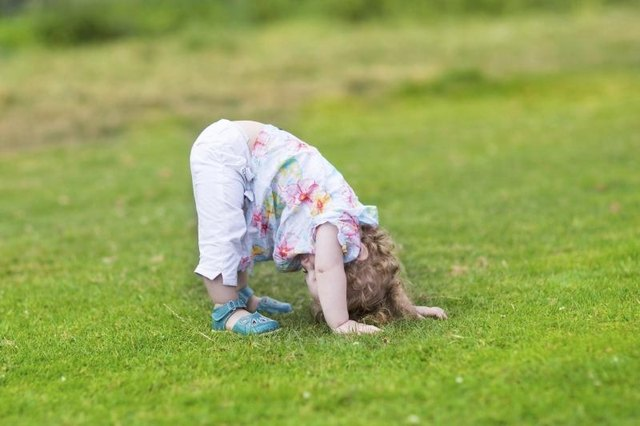 Preschooler streching in grass