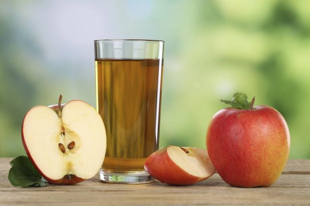 A glass of apple juice.