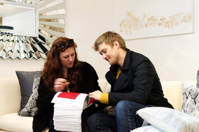 A young couple shopping in a furniture store.