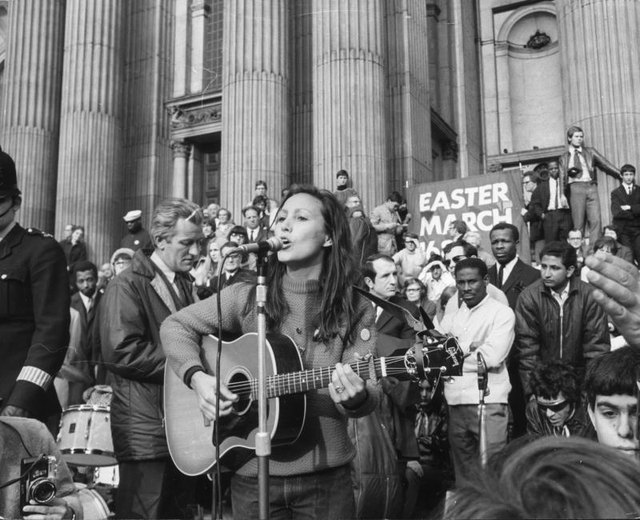 Woman singing at a protest circa 1965