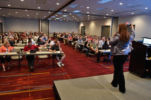 A marketing coordinator presenting a product or service at a conference.