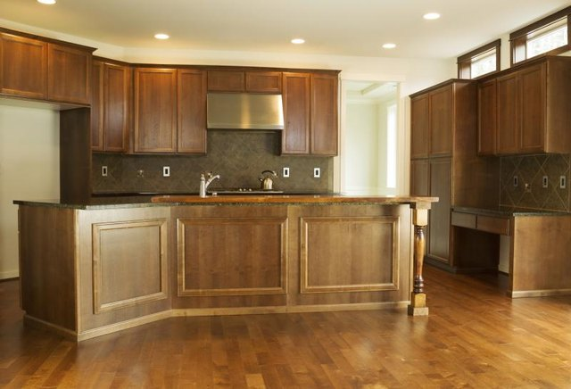 Kitchen with cherry wood cabinets and flooring