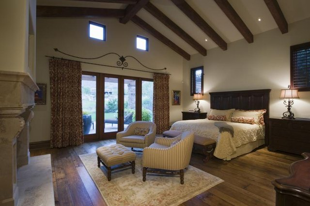Large bedroom with exposed wood beam ceiling.