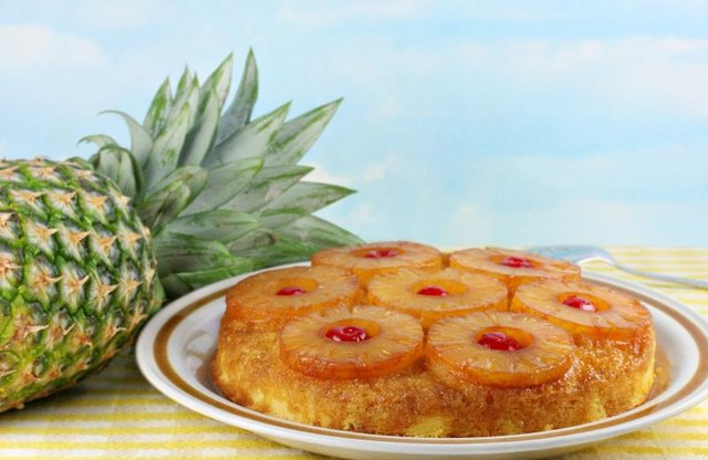 Pineapple upside down cake next to a pineapple