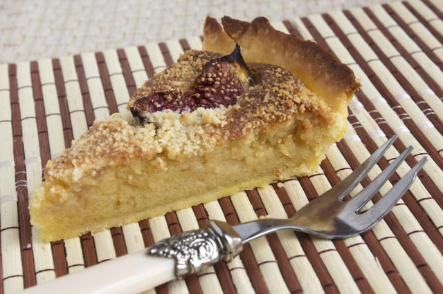 A slice of almond marzipan cream and figs pie