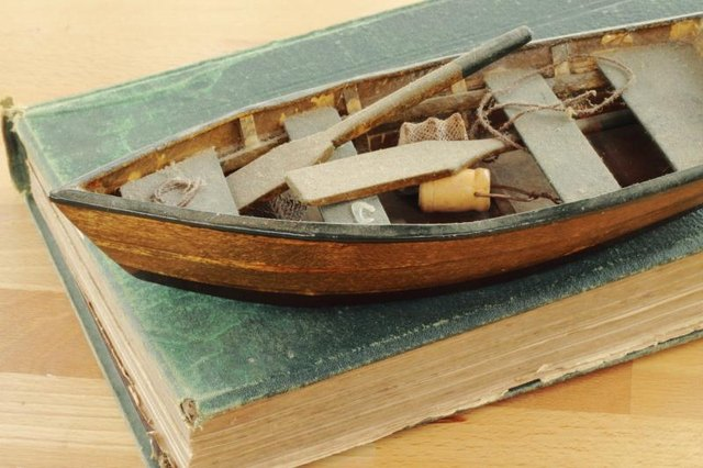 Miniature boat on a book.
