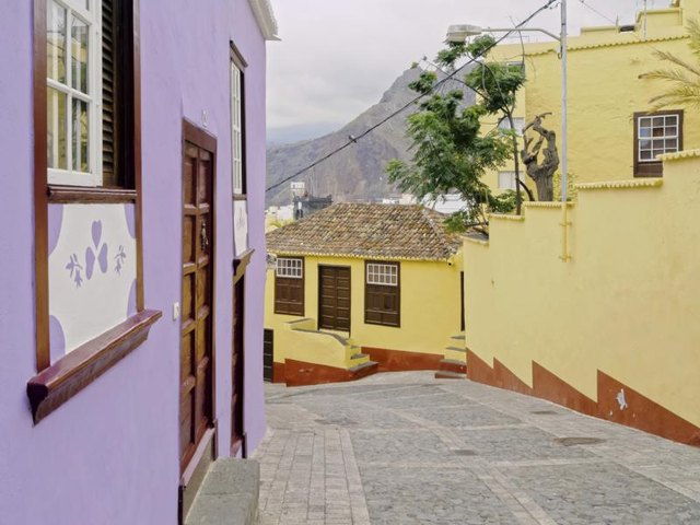 An alley between two colorful houses