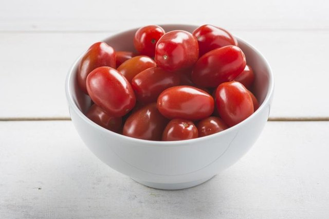 A bowl of ripe, grape tomatoes.