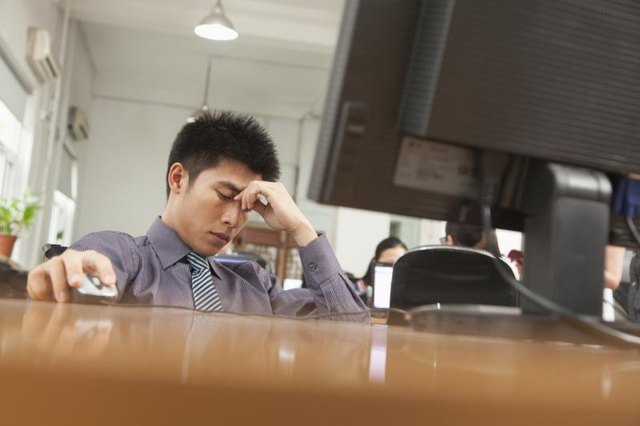 Stressed businessman at work