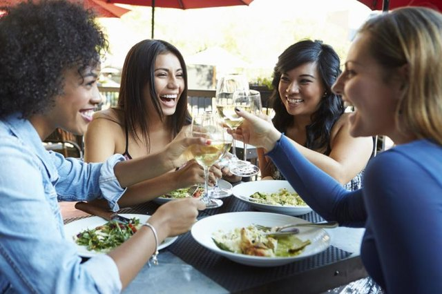 Women toasting at restaurant.