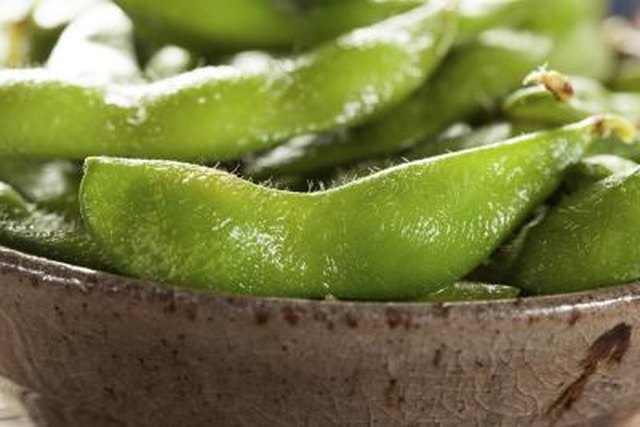 A close-up of salted edamame.