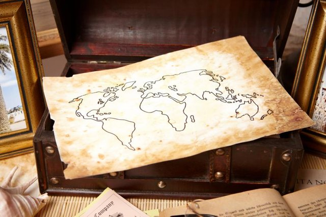 An antique map inside of a trunk.