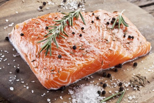 Fresh raw salmon with herbs and spices