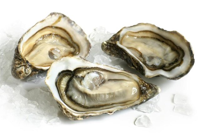 Oysters can be eaten raw or cooked to increase zinc levels.