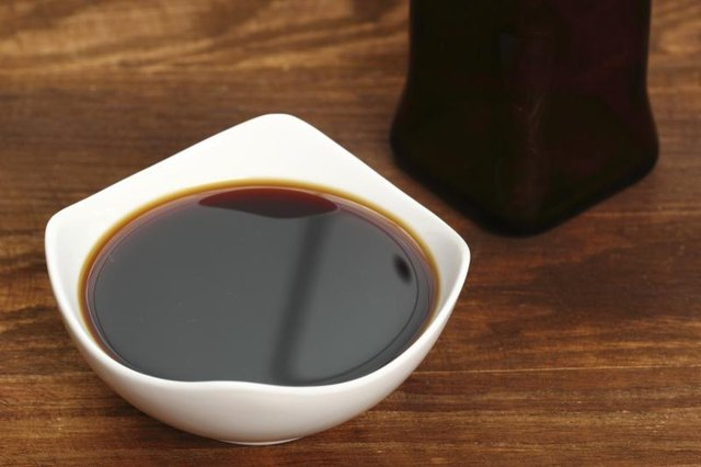 A bowl filled with soy sauce.