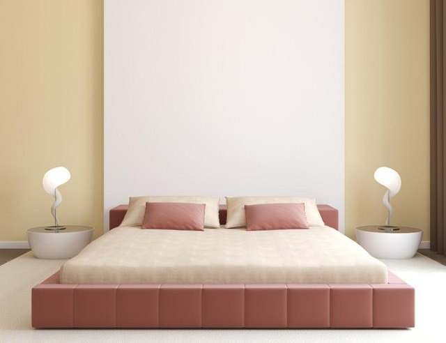 A minimalist style contemporary bedroom with a pink and beige color scheme.