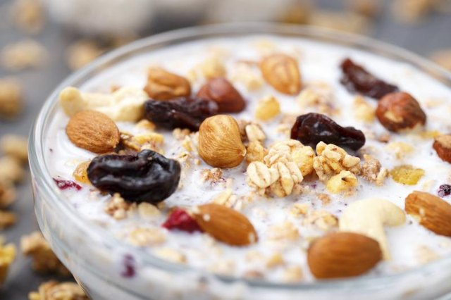 Bowl of oatmeal with raisins and almonds.