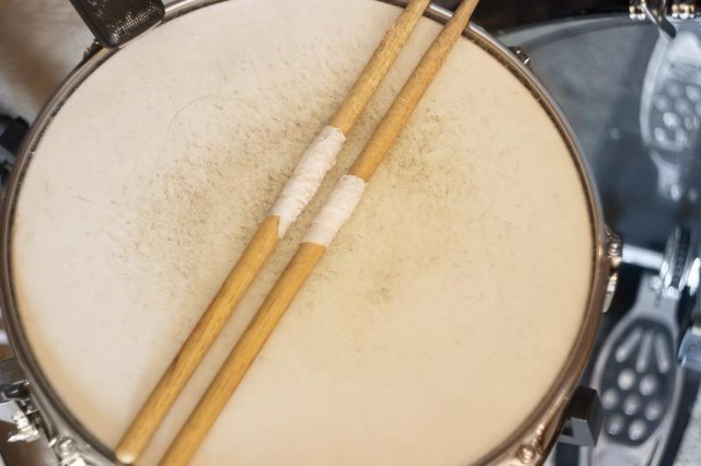A drum and drumsticks.