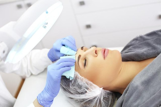 Esthetician providing skin-care treatment to patient