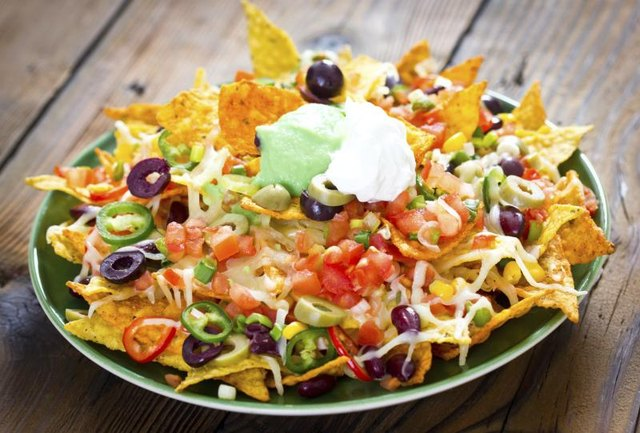 Plate with loaded nachos.