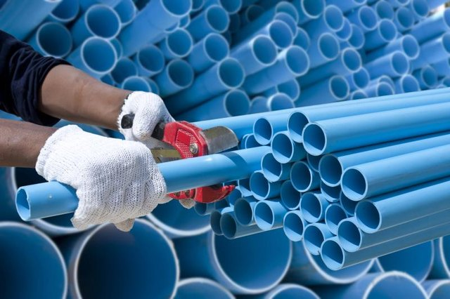 Blue PVC pipe being cut.