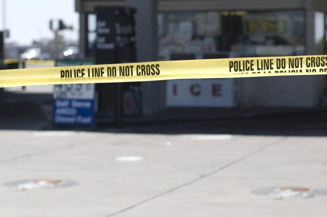 Police tape surrounding a crime scene.