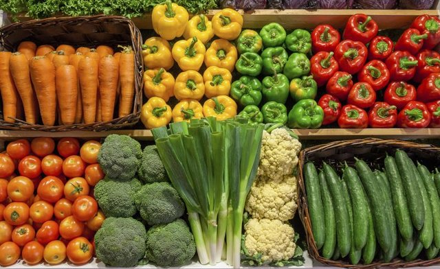 Variety of vegetables on display at a grocery store