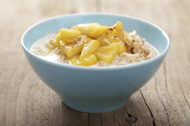 A bowl of oatmeal with caramelized apples.