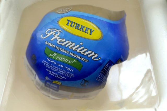 Defrosting the turkey completely is important to ensure even cooking.
