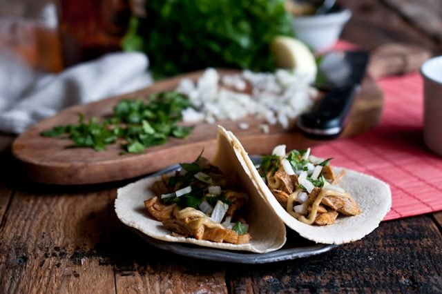 These beer braised chicken tacos use a fragrant blend of spices to season the succulent chicken thigh meat.