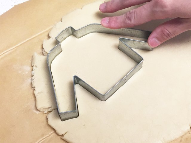 Cutting out a sweater-shaped cookie