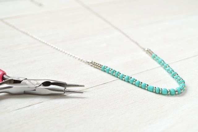 Use basic jewelry-making techniques to shorten a long necklace.