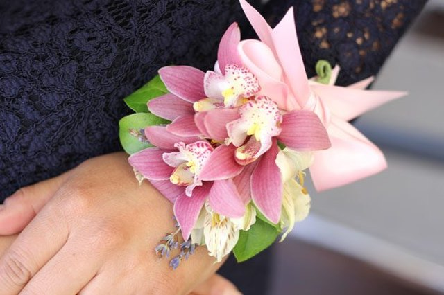 A wrist corsage beautifully sets off any mother-of-the-bride (or groom) ensemble.