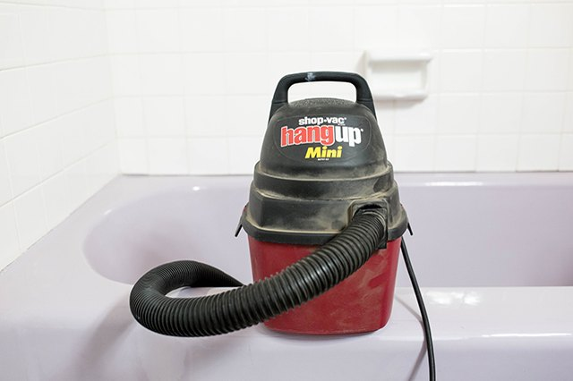 Use a shop vacuum cleaner to remove dust and debris from the work area.