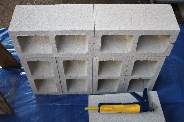 This top row of cinder blocks will hold the wood posts.