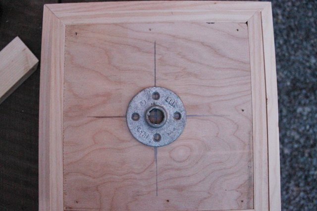 Find the center of the top box and attach the floor flange.