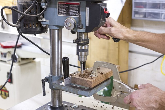 Drill out the four holes to be used for pencils with a drill press.
