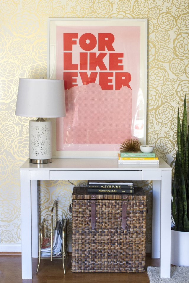 Adding wallpaper to a wall in your room creates a budget-friendly focal point.